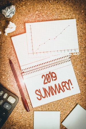 Handwriting text writing 2019 Summary. Conceptual photo summarizing past year events main actions or good shows Desk notebook paper office cardboard paperboard study supplies table chart