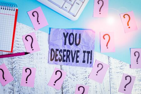 Text sign showing You Deserve It. Business photo showcasing should have it because of their qualities or actions Writing tools, computer stuff and math book sheet on top of wooden table