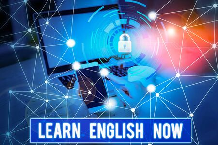 Conceptual hand writing showing Learn English Now. Concept meaning gain or acquire knowledge and skill of english language Picture photo network scheme with modern smart device
