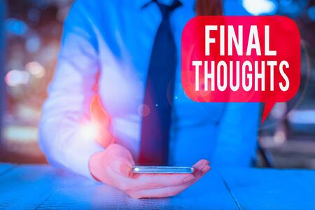 Writing note showing Final Thoughts. Business concept for the conclusion or last few sentences within your conclusion Female business person sitting by table and holding mobile phone
