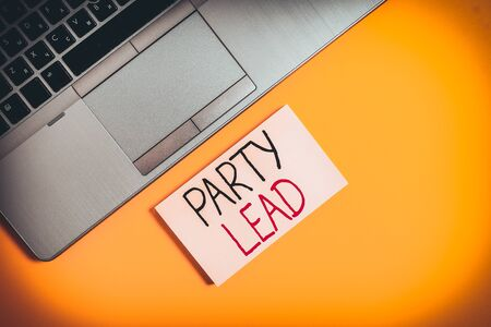 Word writing text Party Lead. Business photo showcasing acts as the official representative of their political party Slim trendy silver open laptop square sticky notepad colored background