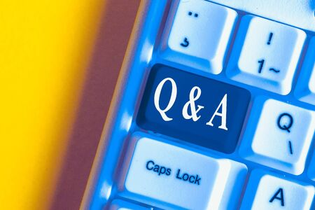 Handwriting text Q And A. Conceptual photo defined as questions being asked and answers White pc keyboard with empty note paper above white background key copy space