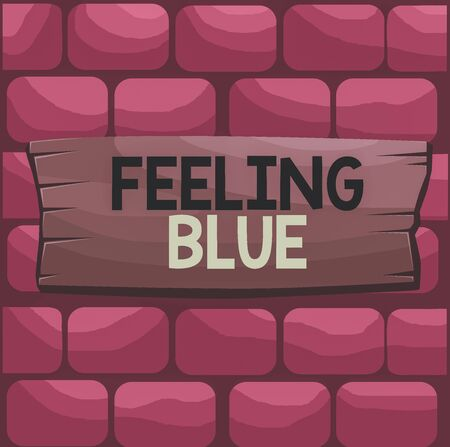 Handwriting text Feeling Blue. Conceptual photo Feeling of desperation because of sadness or missing someone Plank wooden board blank rectangle shaped wood attached color background