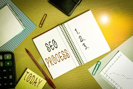 Text sign showing Seo Process. Business photo showcasing steps of increasing the quality and quantity of website traffic Striped paperboard notebook cardboard office study supplies chart paper Stock Photo