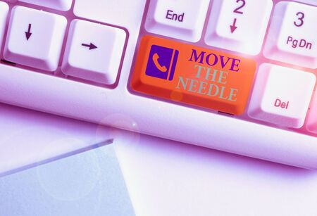 Text sign showing Move The Needle. Business photo showcasing Make a noticeable difference in something do better White pc keyboard with empty note paper above white background key copy space Stock Photo