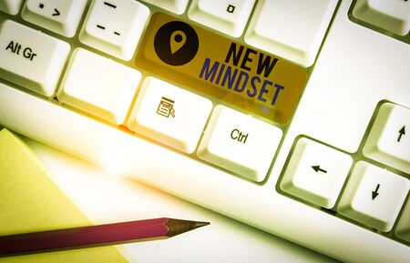 Word writing text New Mindset. Business photo showcasing Mental attitude or disposition New approach in dealing situation White pc keyboard with empty note paper above white background key copy space Фото со стока