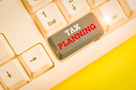 Word writing text Tax Planning. Business photo showcasing analysis of financial situation or plan from a tax perspective White pc keyboard with empty note paper above white background key copy space