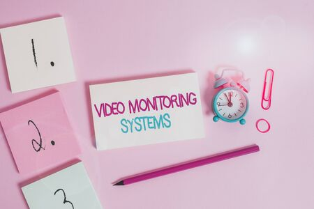 Writing note showing Video Monitoring Systems. Business concept for Surveillance Transmit capture Image to Digital Link Blank notepads marker rubber band alarm clock clip colored background