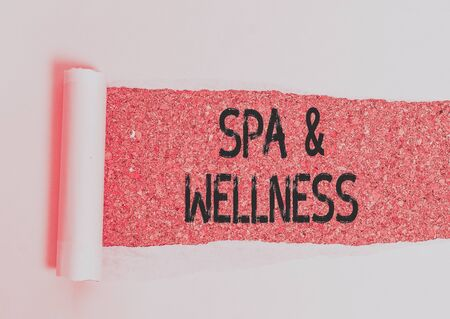 Conceptual hand writing showing Spa And Wellness. Concept meaning Place where showing go to improve their health Relaxation Cardboard which is torn placed above a wooden classic table Фото со стока