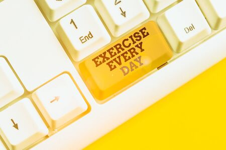 Text sign showing Exercise Every Day. Business photo text move body energetically in order to get fit and healthy White pc keyboard with empty note paper above white background key copy space