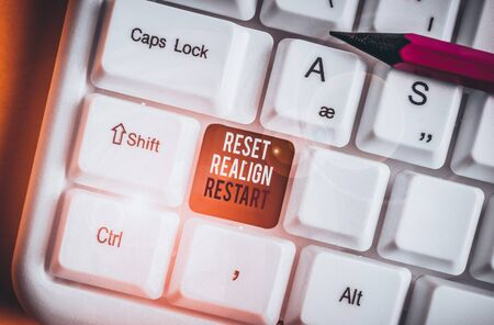 Word writing text Reset Realign Restart. Business photo showcasing Life audit will help you put things in perspectives White pc keyboard with empty note paper above white background key copy space 写真素材