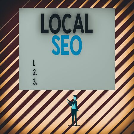 Text sign showing Local Seo. Business photo showcasing helps businesses promote products and services to local customers Short hair immature young man stand in front of rectangle big blank board