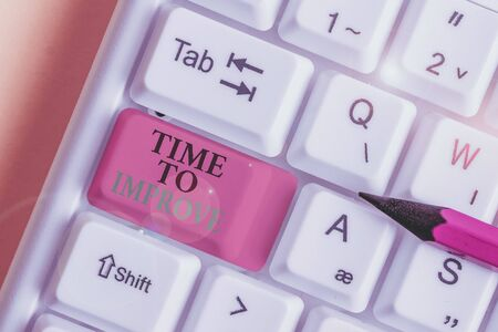 Conceptual hand writing showing Time To Improve. Concept meaning telling someone to develop himself Study hard Courses White pc keyboard with note paper above the white background
