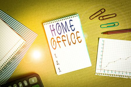Handwriting text writing Home Office. Conceptual photo space designated in a demonstrating s is residence for official business Striped paperboard notebook cardboard office study supplies chart paper Stok Fotoğraf