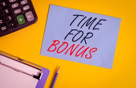 Writing note showing Time For Bonus. Business concept for a sum of money added to a demonstrating s is wages as a reward Clipboard blank sheet square page calculator pencil colored background 写真素材