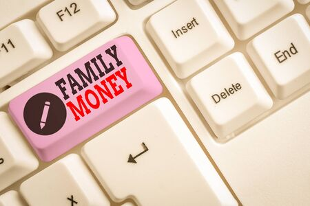 Text sign showing Family Money. Business photo text the inherited wealth of established upperclass families White pc keyboard with empty note paper above white background key copy space