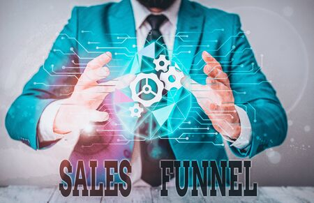 Handwriting text Sales Funnel. Conceptual photo process through which a company ells its products to buyers Male human wear formal work suit presenting presentation using smart device