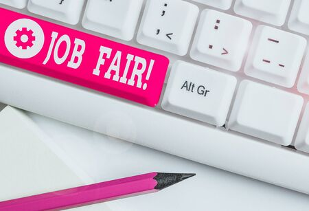 Word writing text Job Fair. Business photo showcasing event in which employers recruiters give information to employees White pc keyboard with empty note paper above white background key copy space