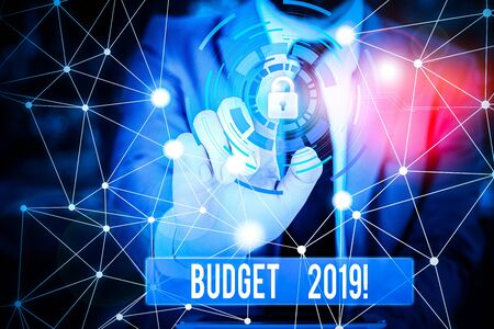 Writing note showing Budget 2019. Business concept for estimate of income and expenditure for current year Picture photo network scheme with modern smart device 写真素材