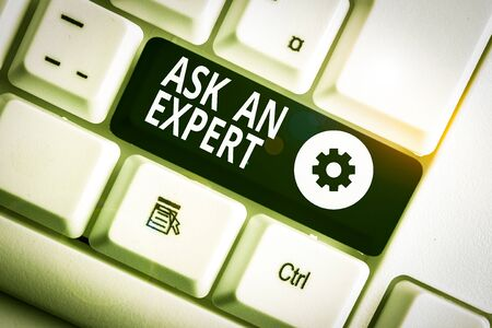 Writing note showing Ask An Expert. Business concept for consult someone who has skill about something or knowledgeable White pc keyboard with note paper above the white background Stockfoto