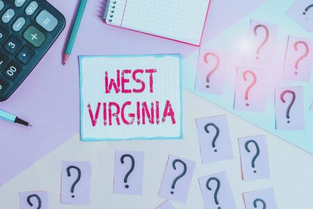 Writing note showing West Virginia. Business concept for United States of America State Travel Tourism Trip Historical Mathematics stuff and writing equipment above pastel colours background