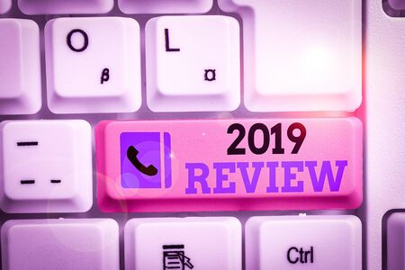 Conceptual hand writing showing 2019 Review. Concept meaning New trends and prospects in tourism or services for 2019 Keyboard with note paper on white background key copy space