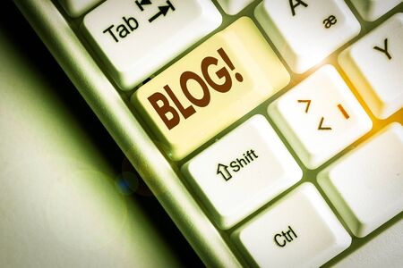 Conceptual hand writing showing Blog. Concept meaning regularly updated website or web page run by an individual or group White pc keyboard with note paper above the white background