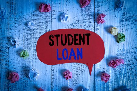 Conceptual hand writing showing Student Loan. Concept meaning financial assistance designed to help students pay for school Colored speech bubble paper balls wooden rustic vintage background