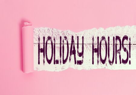 Handwriting text Holiday Hours. Conceptual photo Overtime work on for employees under flexible work schedules Cardboard which is torn in the middle placed above a wooden classic table