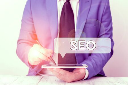 Text sign showing Seo. Business photo text incredibly effective way to market your near business online Businessman pointing with pen in empty copy space