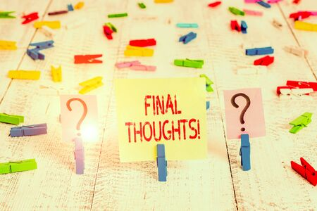 Writing note showing Final Thoughts. Business concept for should be last few sentences within your conclusions Crumbling sheet with paper clips placed on the wooden table