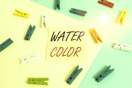 Word writing text Water Color. Business photo showcasing watersoluble binder such as gum arabic and thinned with water Colored clothespin paper empty reminder yellow blue floor background office