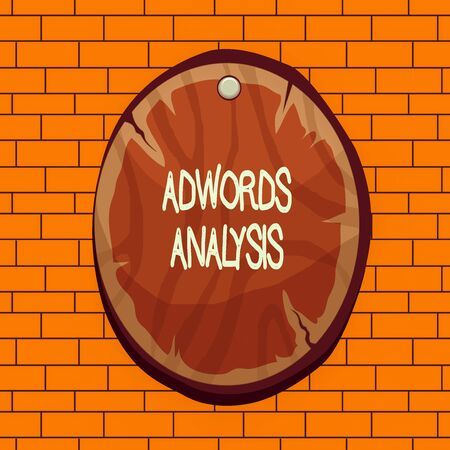 Text sign showing Adwords Analysis. Business photo text monitor campaigns and ensuring investment returns in ads Oval plank rounded pinned wooden board circle shaped wood nailed background