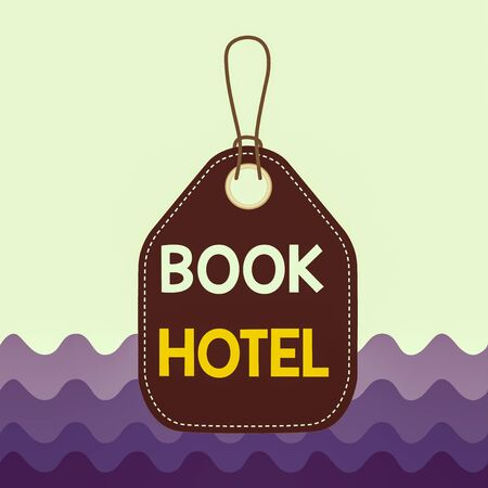 Text sign showing Book Hotel. Business photo showcasing an arrangement you make to have a hotel room or accommodation Empty tag blank space colorful background label rectangle attached string