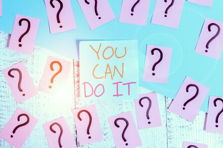 Word writing text You Can Do It. Business photo showcasing Bring it On Believing to oneself Give a try Take the chance Scribbled and crumbling papers with thick cardboard above wooden table Stock fotó