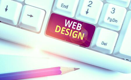 Conceptual hand writing showing Web Design. Concept meaning Website development Designing and process of creating websites White pc keyboard with note paper above the white background Stock Photo