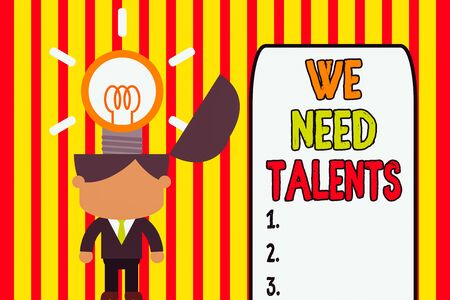 Writing note showing We Need Talents. Business concept for seeking for creative recruiters to join company or team Standing successful man suit necktie surging innovative solutions