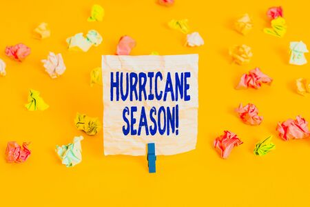 Writing note showing Hurricane Season. Business concept for time when most tropical cyclones are expected to develop Colored crumpled paper empty reminder white floor clothespin