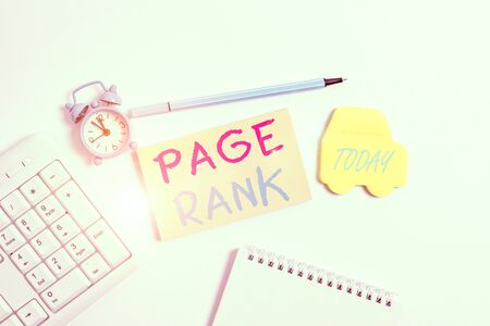 Word writing text Page Rank. Business photo showcasing a value assigned to a web page as a measure of its popularity Copy space on empty note paper with clock and pencil on the table