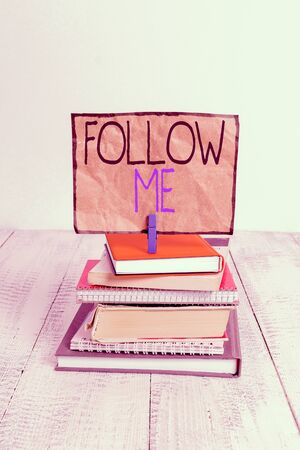 Conceptual hand writing showing Follow Me. Concept meaning Inviting a demonstrating or group to obey your prefered leadership pile stacked books notebook pin color reminder white wooden