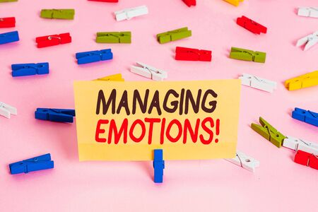 Conceptual hand writing showing Managing Emotions. Concept meaning ability be open to feelings and modulate them in oneself Colored clothespin papers empty reminder pink floor office