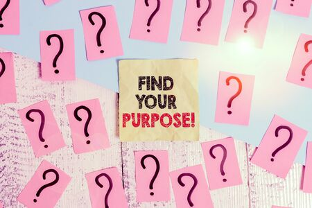 Text sign showing Find Your Purpose. Business photo text reason for something is done or for which still exists Scribbled and crumbling papers with thick cardboard above wooden table