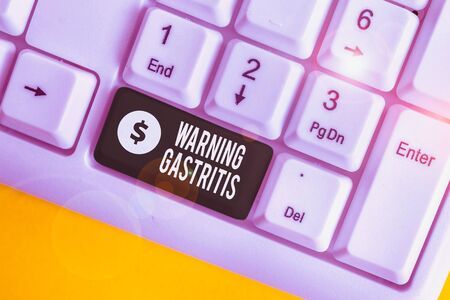 Handwriting text writing Warning Gastritis. Conceptual photo early advice on inflammation of the lining of the stomach White pc keyboard with empty note paper above white background key copy space