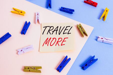 Word writing text Travel More. Business photo showcasing To make a journey often especially on long distance trip Colored clothespin paper empty reminder yellow blue floor background office