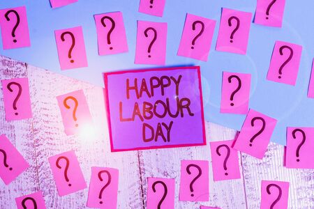 Handwriting text Happy Labour Day. Conceptual photo annual holiday to celebrate the achievements of workers Scribbled and crumbling papers with thick cardboard above wooden table