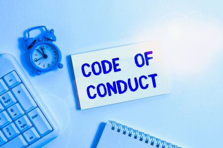Conceptual hand writing showing Code Of Conduct. Concept meaning Ethics rules moral codes ethical principles values respect Keyboard with empty note paper and pencil white background