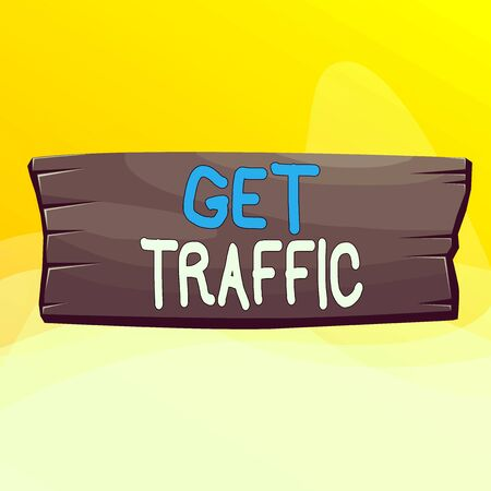 Writing note showing Get Traffic. Business concept for amount of data sent and received by visitors to a website Wooden board rectangle shaped wood attached color background
