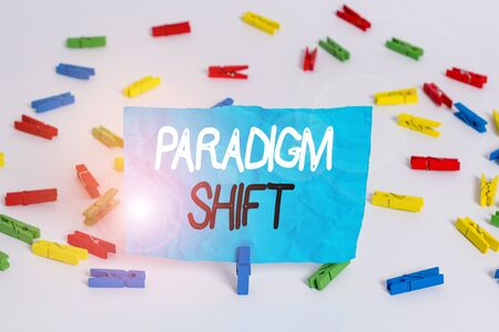 Handwriting text writing Paradigm Shift. Conceptual photo fundamental change in approach or underlying assumptions Colored clothespin papers empty reminder white floor background office Stock fotó - 138472407