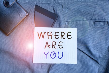 Conceptual hand writing showing Where Are You. Concept meaning Give us your location address direction point of reference Smartphone device inside trousers front pocket with wallet