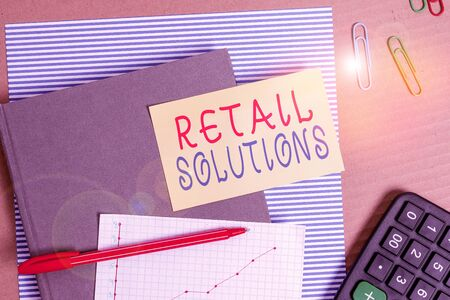 Text sign showing Retail Solutions. Business photo showcasing process of promoting greater sale and customer satisfaction Striped paperboard notebook cardboard office study supplies chart paper Stock Photo
